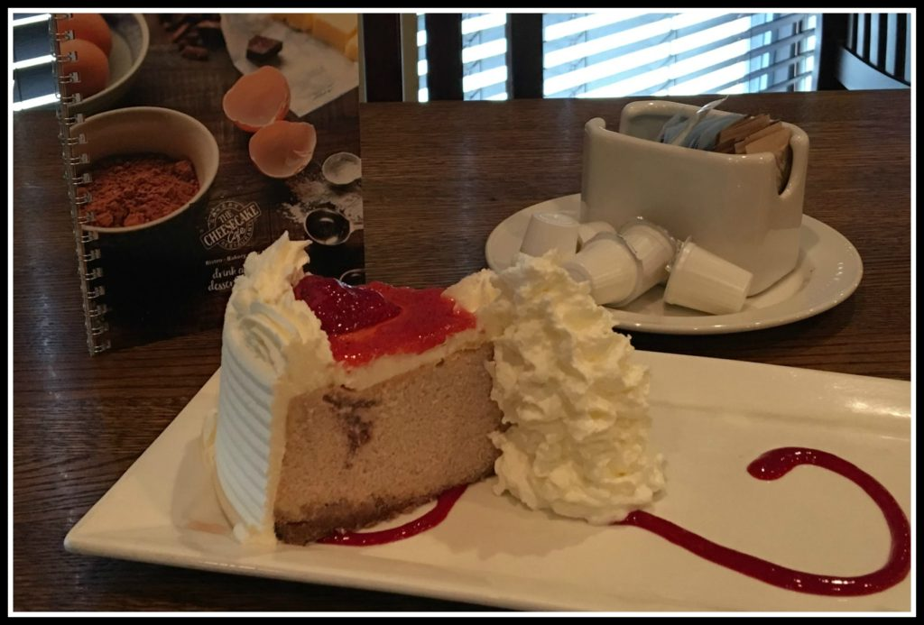 Coffee and delicious piece of cheesecake at the Cheesecake Cafe