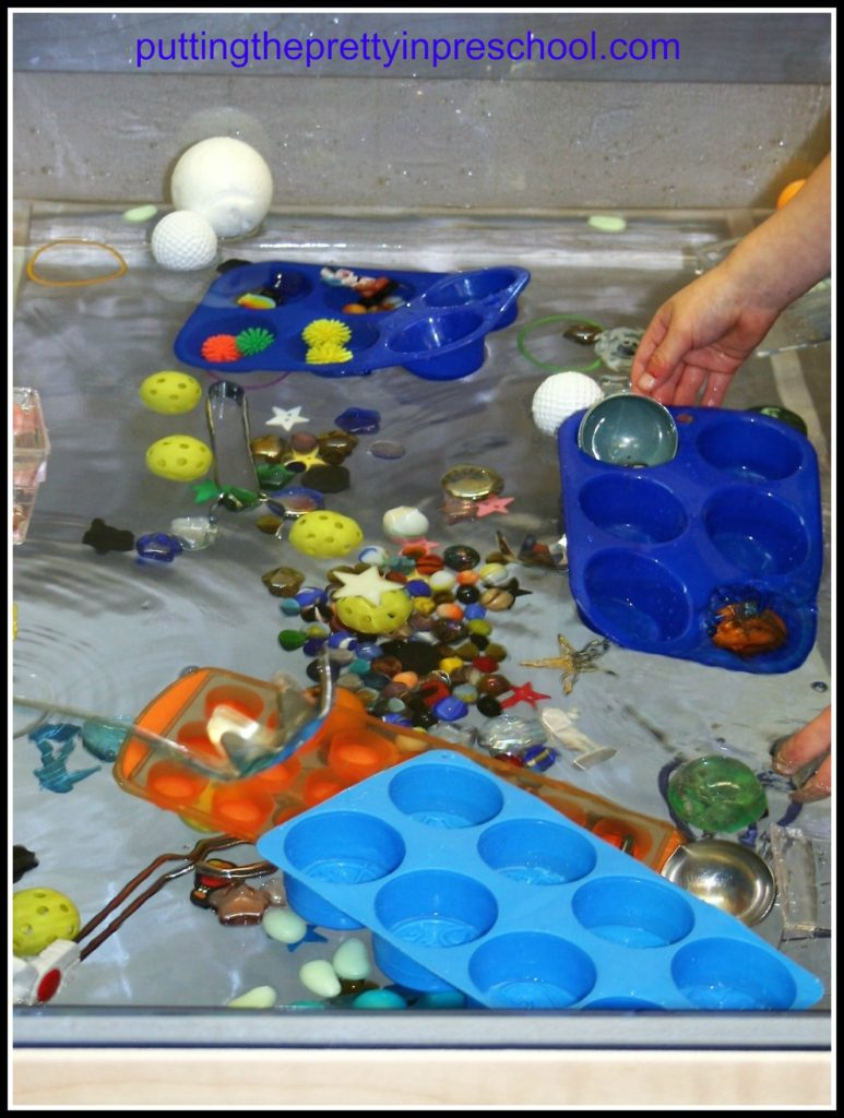 Space themed water table with sun, moon, star and planet shapes to use with scoops and sorting trays.