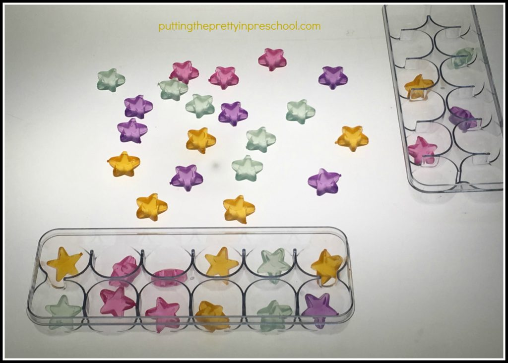 Transparent star shaped ice cubes to sort at a light table.