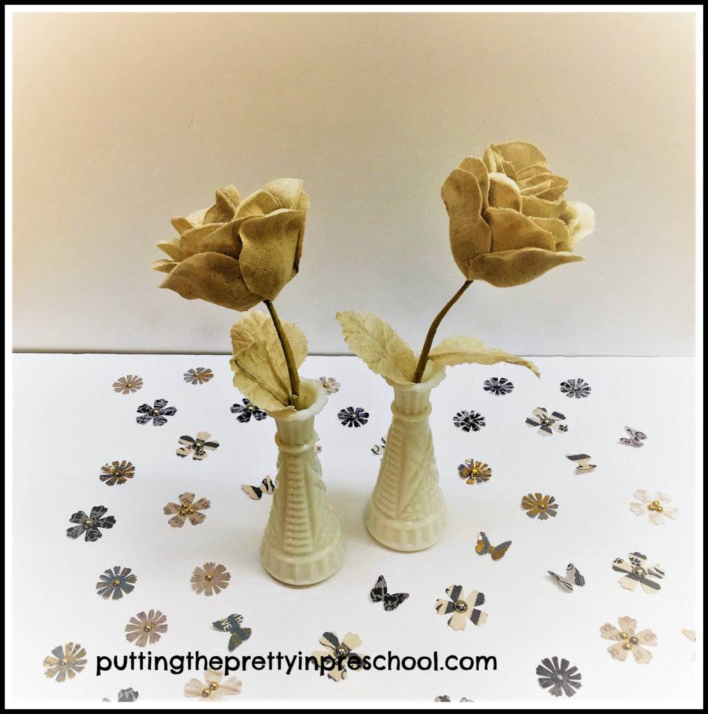 Tan denim cloth flowers and butterfly and flower table scatter.