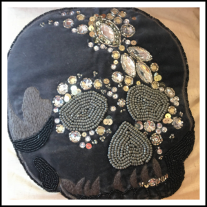 Glam skull pillow.