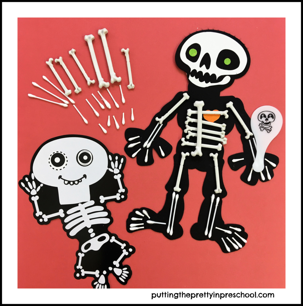 Felt skeleton decorated with plastic and Q-Tip bones. A cardboard skeleton serves as a model.