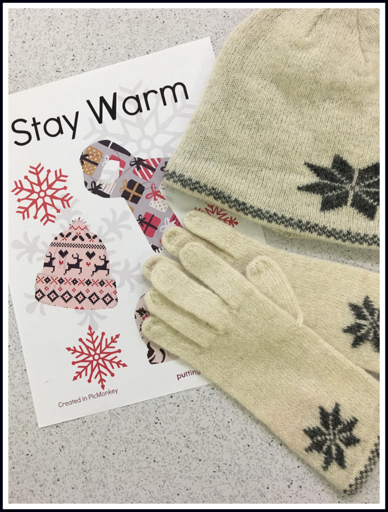 Stay warm station with sign and winter accessories.
