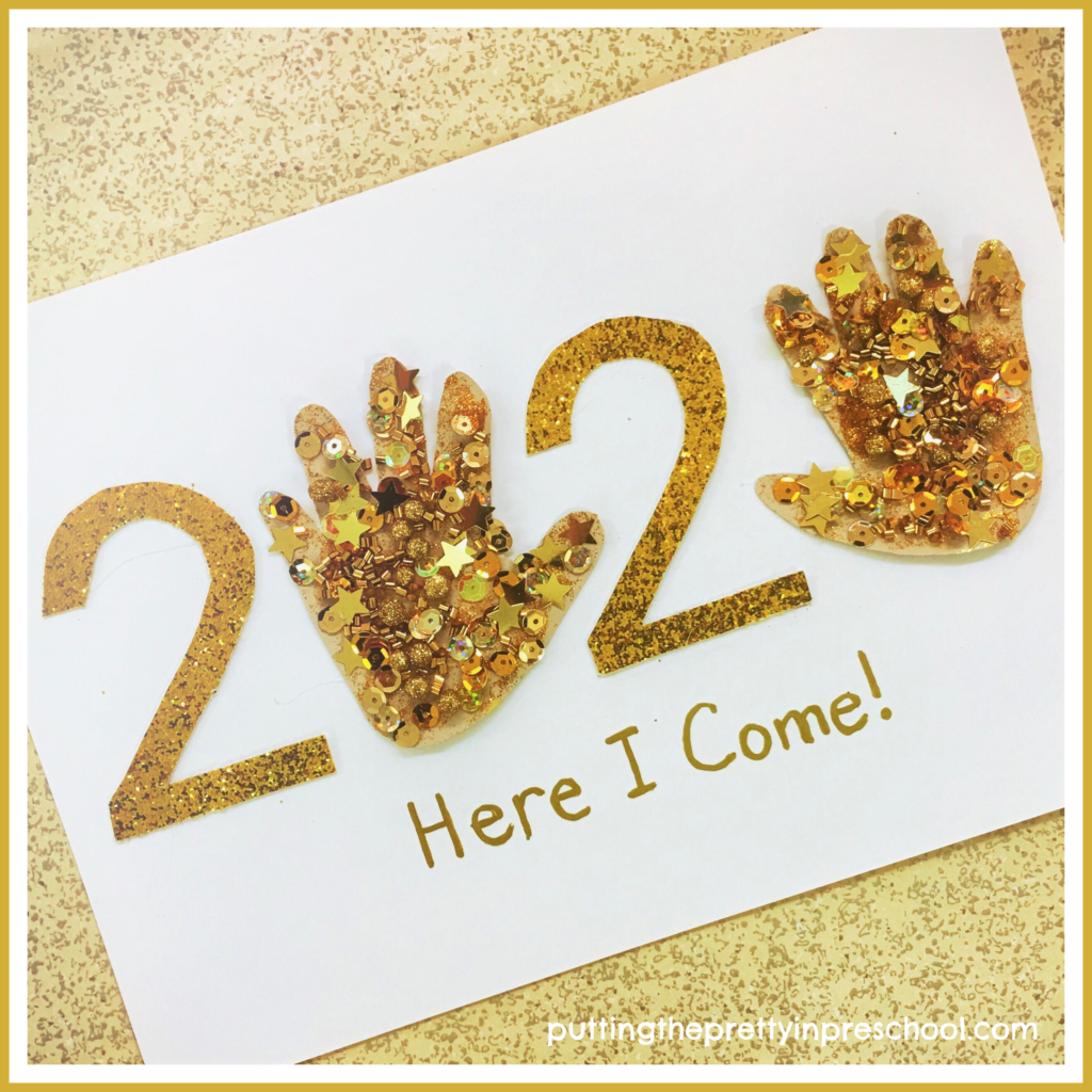 Glitter paper and gold collage items are front and center in this 2020 handprint art activity. An easy to make New Year's keepsake suitable for children of all ages.