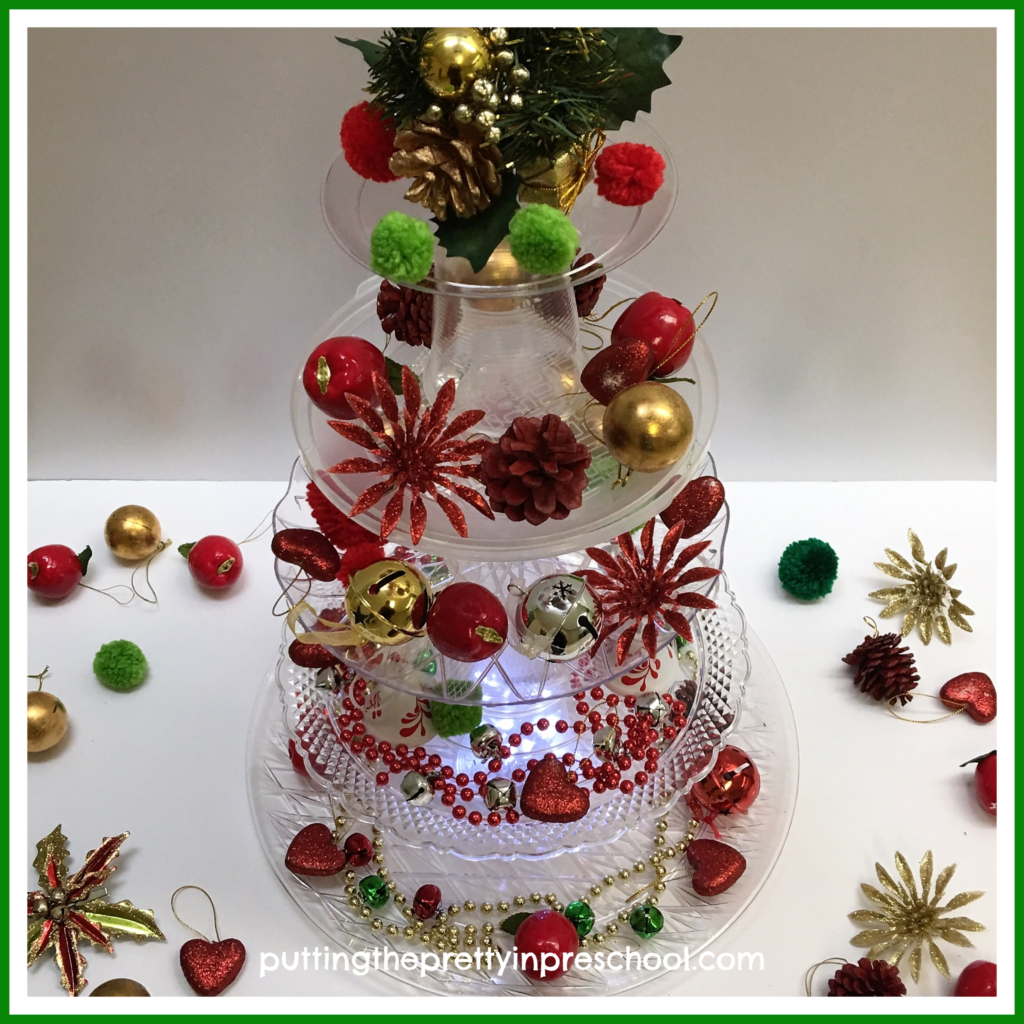 A decorated tower tree using clear plastic plates, serving trays, and cups. A STEAM activity for young learners.