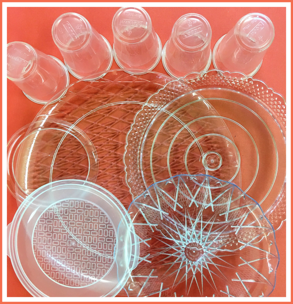 Plastic serving trays, plates, lid and cups to use as a Christmas tower tree building prompt. A family STEAM activity with many possibilities for learning.