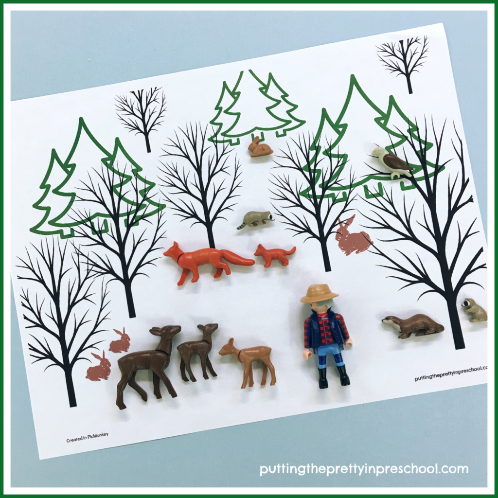 Winter Forest Placemat with animal figures and hiker offer opportunities for imaginative play. Free printable available for download.