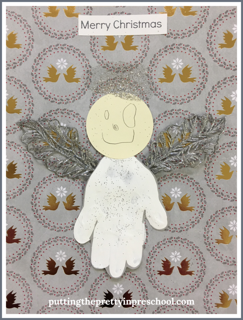 "Handprint angel craft with the caption ""Merry Christmas."" An easy to make keepsake all children can create."