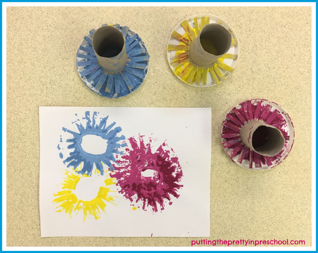 Practice making paint print fireworks on a piece of scrap paper before making prints on the Happy New Year printable.