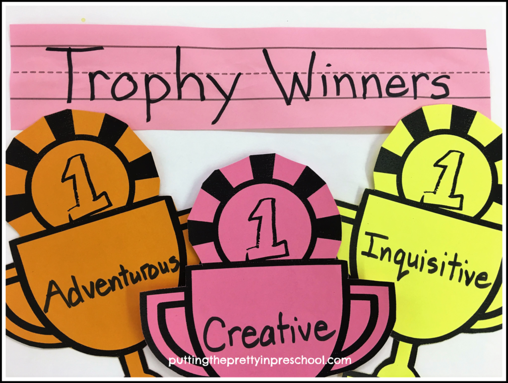 Trophy Winner wall display using colored card stock paper trophies with children's names and a character quality they exemplify.