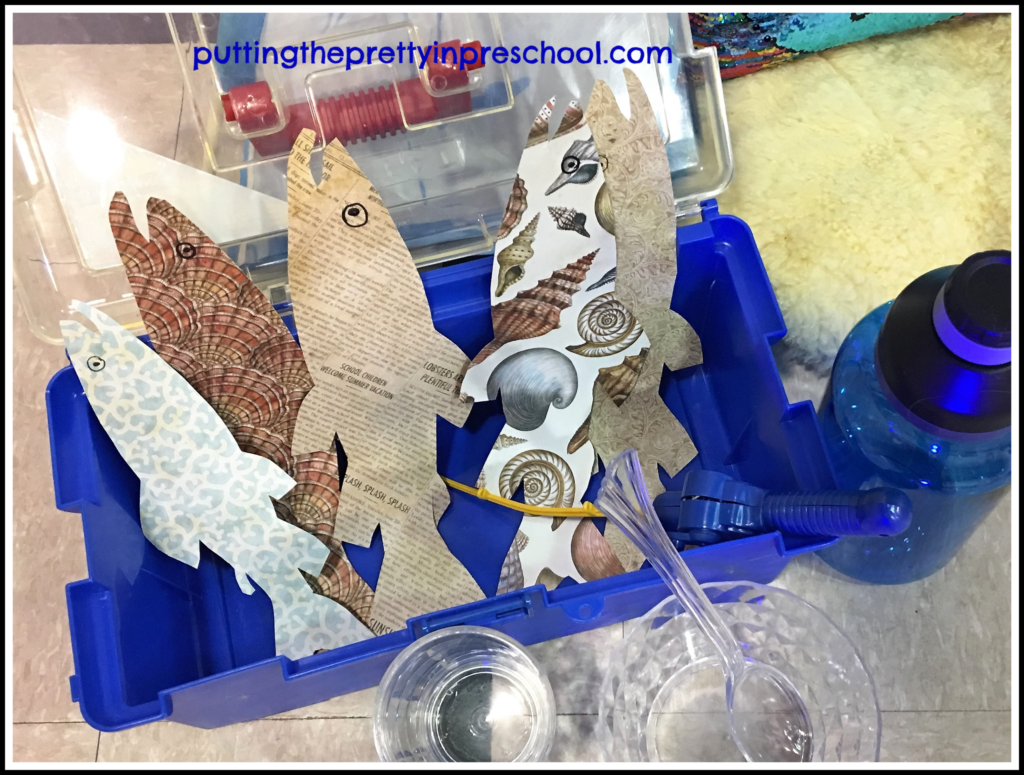 Preschool pretend play center with fishing gear and clear tableware.