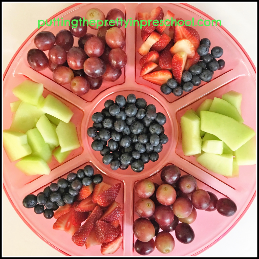Fruit tray with strawberries, blueberries, grapes and honeydew.