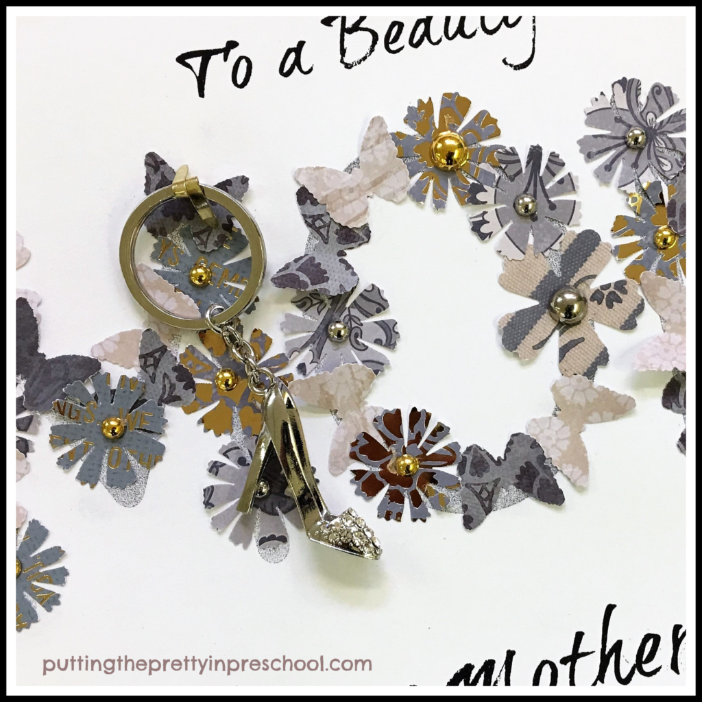 "A pretty key chain gift fastened to the word ""mom"" in a Mother's Day paper collage craft. This art activity is suitable for all ages."