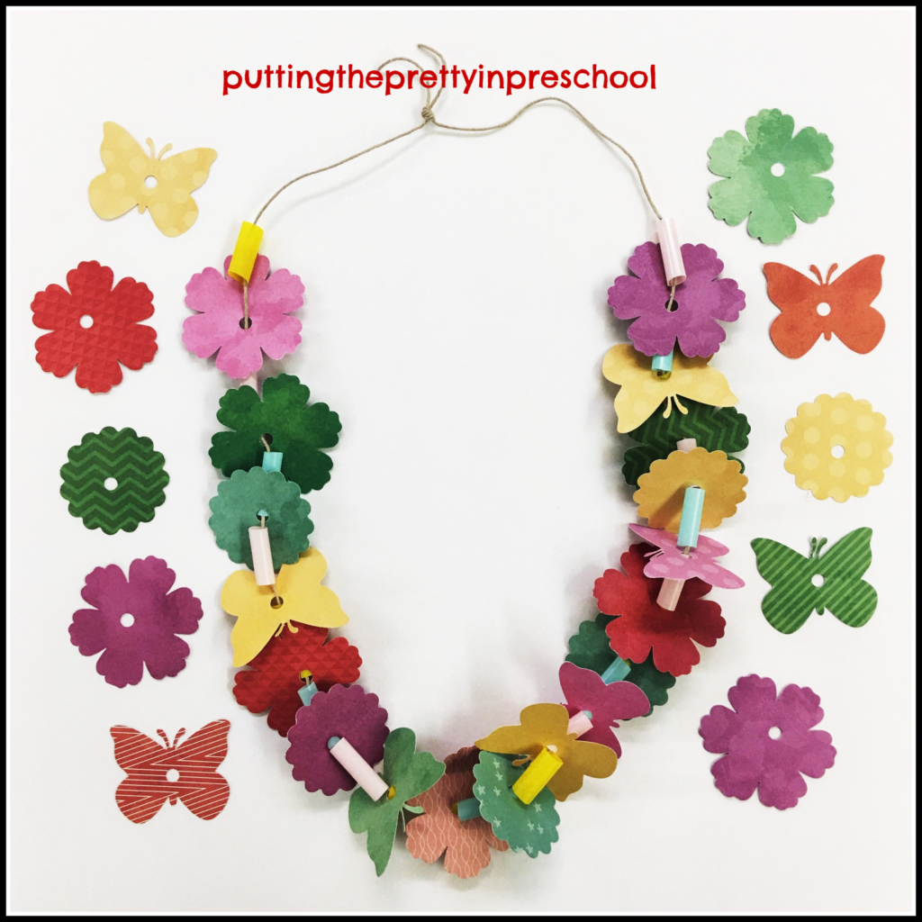 Paper Hawaiian lei party craft suitable for all ages.