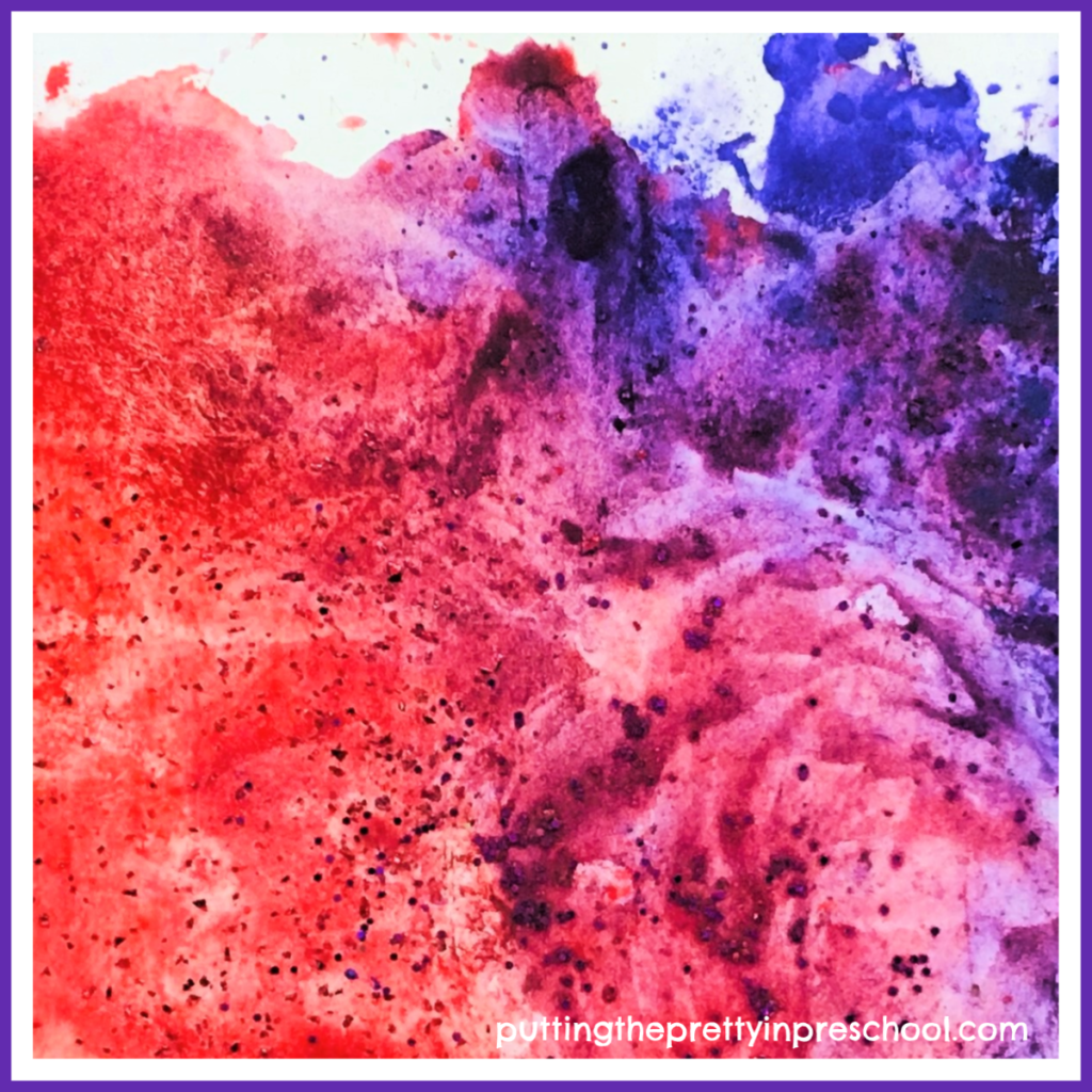 This completed ice cube and powder paint process art picture looks like an exploding volcano on a mountain. It would sizzle as a backdrop for a few painted dinosaurs.