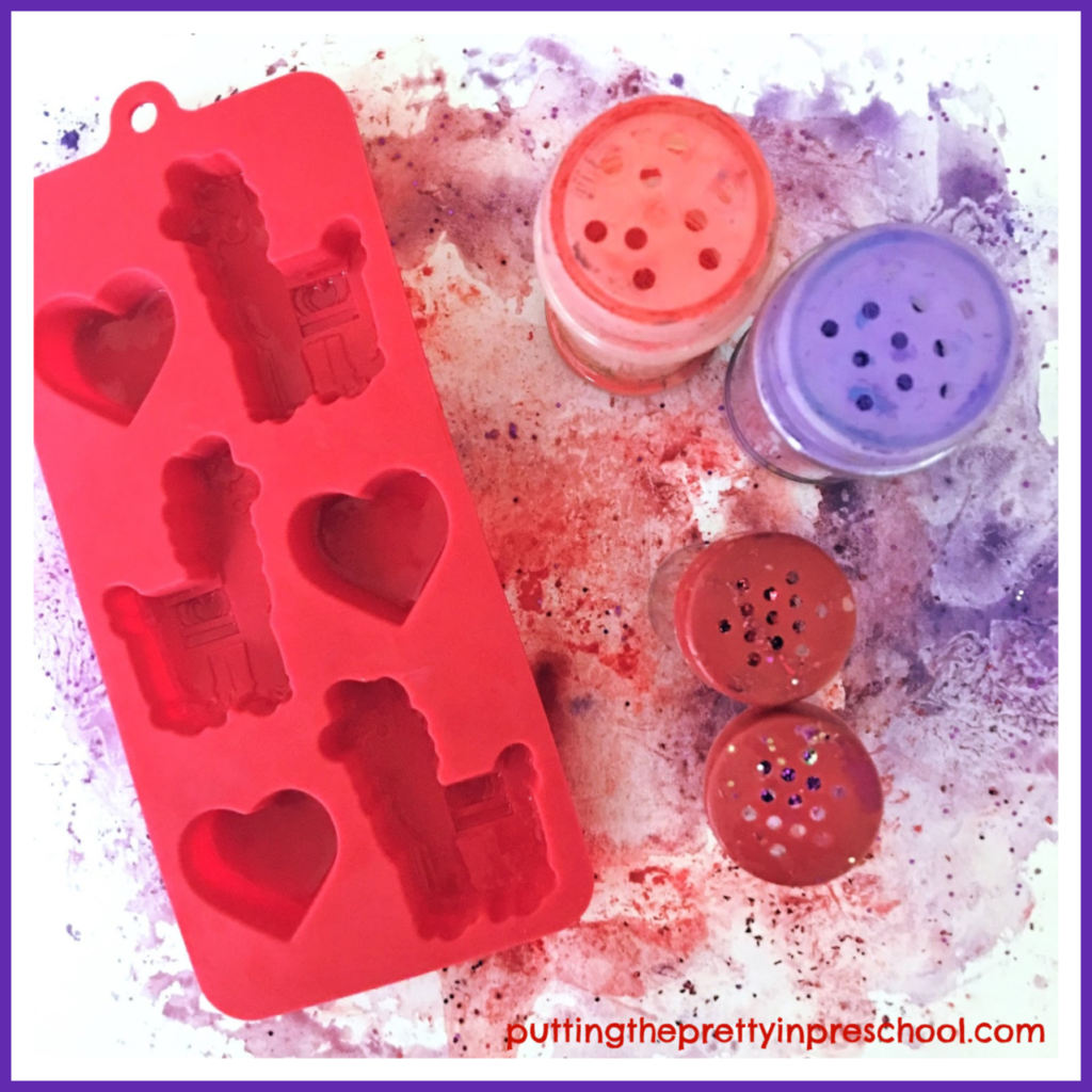 Valentine's Day process art supplies for an ice cube and powder paint technique. Llama shaped ice cubes give the project a South American flair. An art project suitable for all ages.