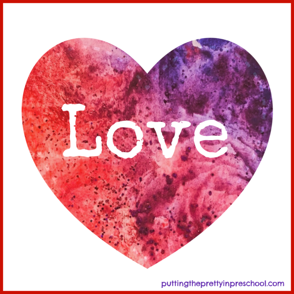 """The word """"Love"""" added to a heart shape cut from a completed ice cube and powder painted picture. This Valentine's Day process art activity is suitable for all ages."""