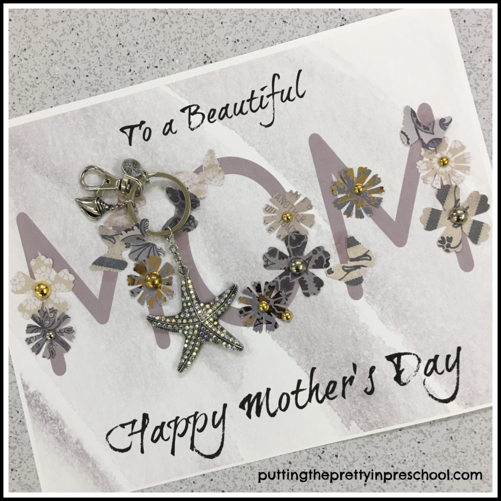 Mother's Day collage craft with flowers and butterflies glued on to the word 'Mom.' A starfish keychain is fastened on as a gift. This craft is suitable for all ages.