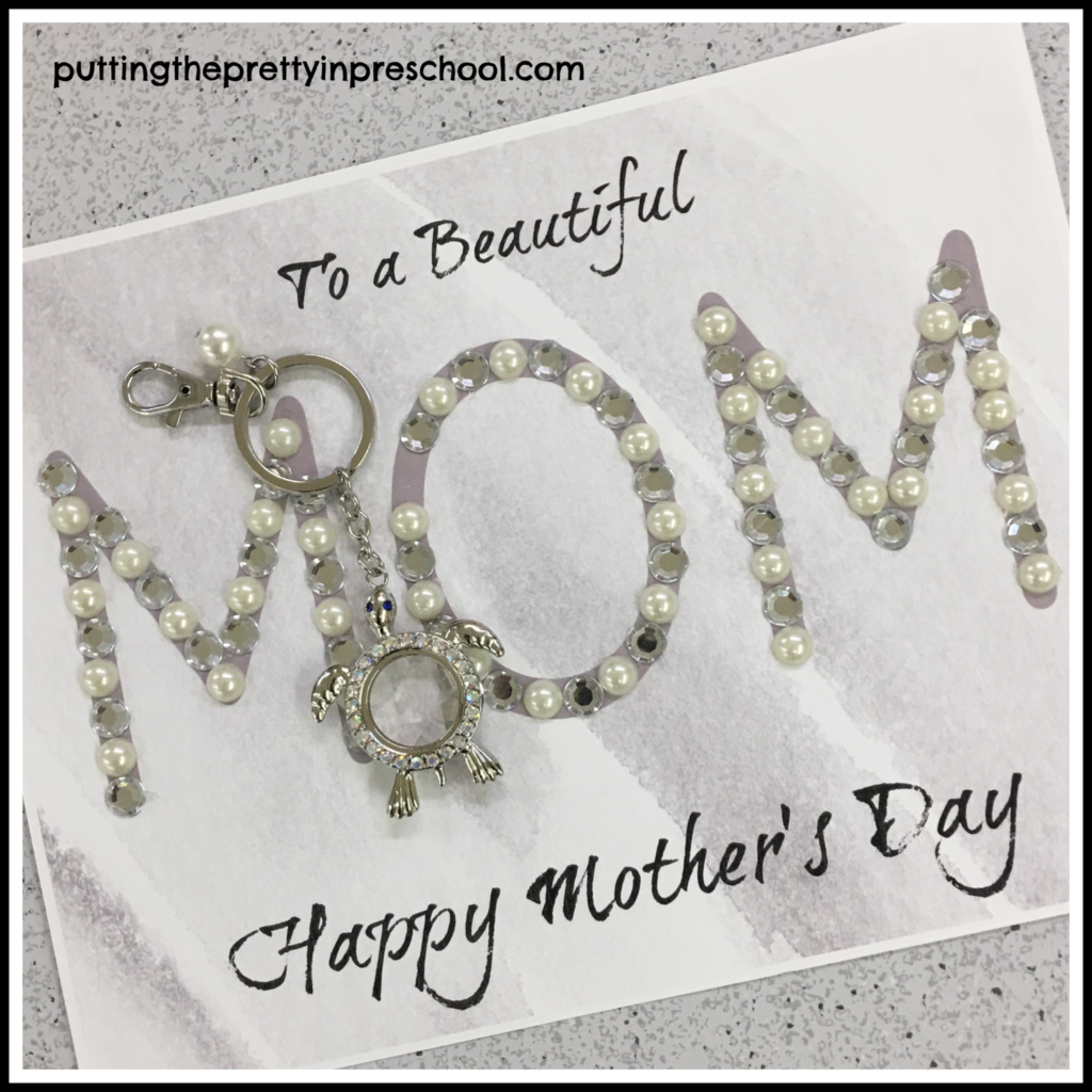Mother's Day craft with sticker pearls and silver jewels added on the word 'mom.' A sea turtle key chain is added on as a gift. This craft is suitable for all ages.