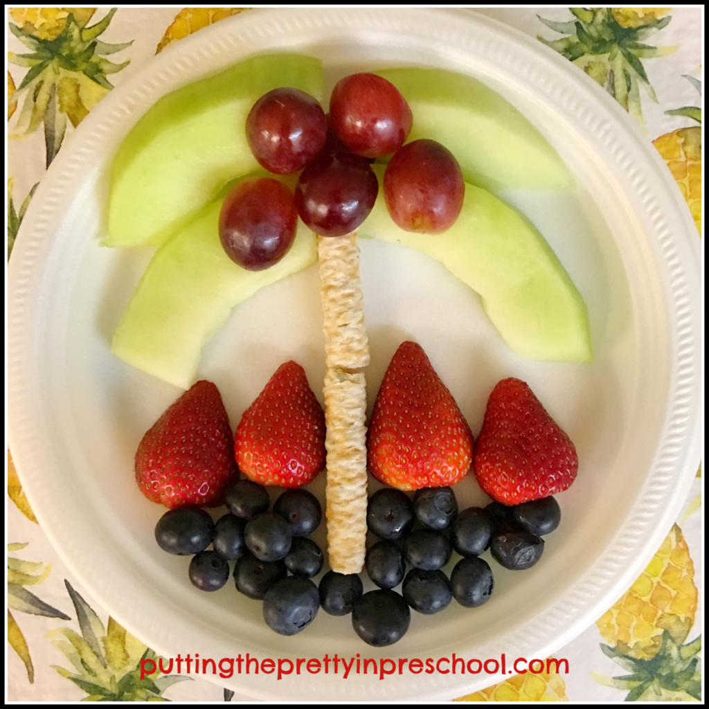 Palm tree scene made with fruit and coconut rolls for a Hawaiian party snack.