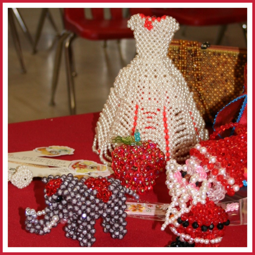 Bead work projects on display at a Chinese Valentine's Day celebration.