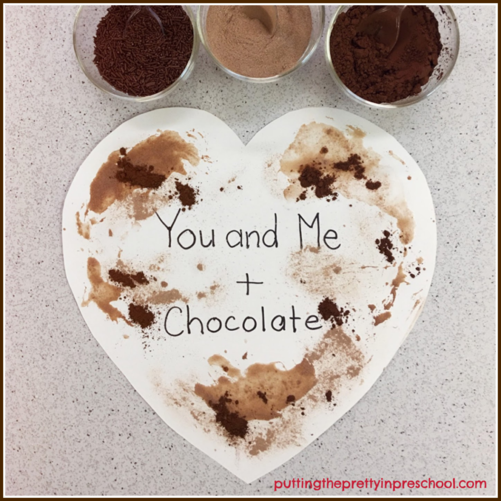 Cocoa and hot chocolate added to a heart shape. Ice cubes can be used to swish the powders around.