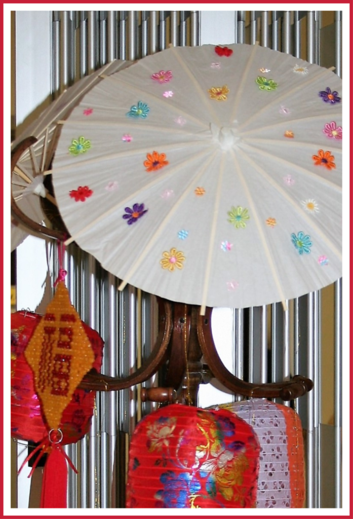 Lanterns and decorated umbrellas at a Chinese Valentine's Day celebration.