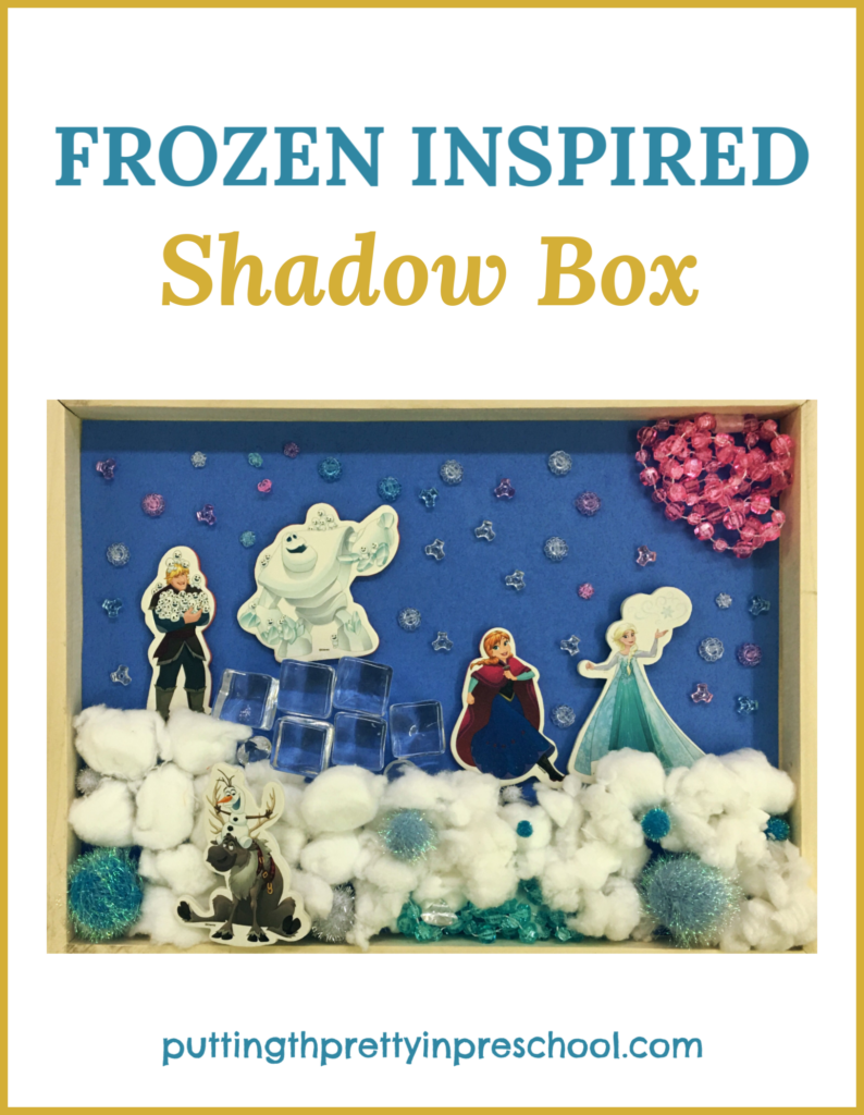 Frozen inspired shadow box. Invitation for children to create a scene with Frozen bathtub stickers and loose parts. An all-ages activity.