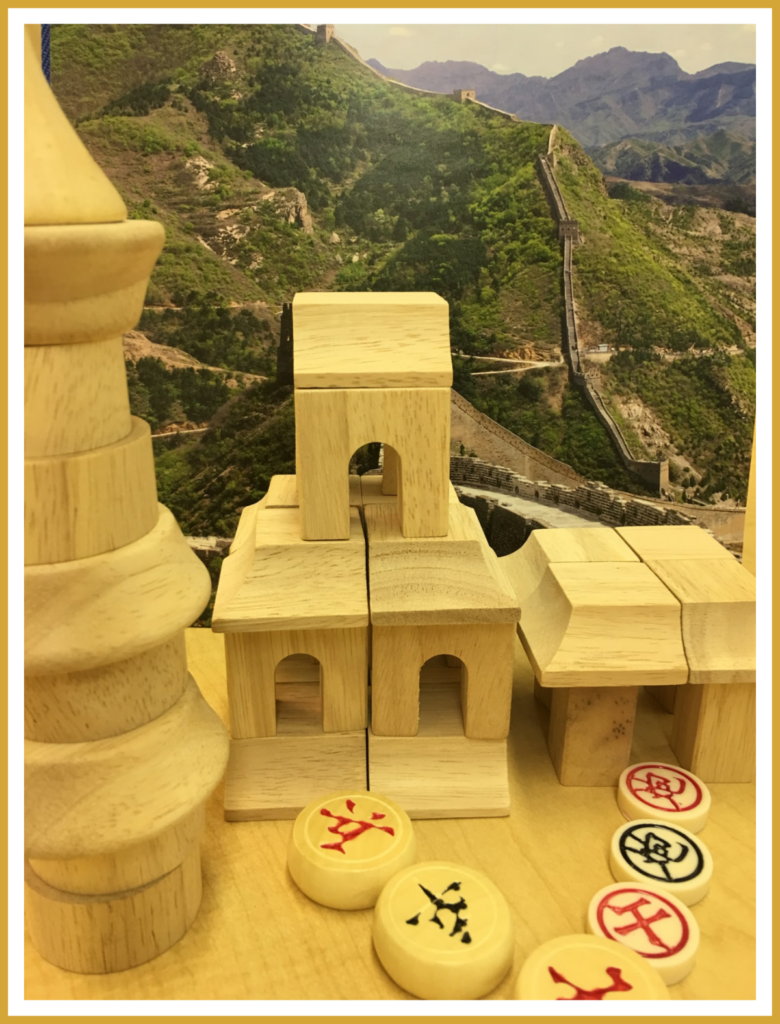 Oriental block play with game chip accessories set against a backdrop featuring the Great Wall of China. An activity perfect for a Chinese multicultural theme.