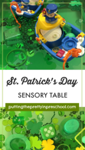 St. Patrick's Day sensory table inspired by the city of Chicago, USA. Green and shamrock themed loose parts invite sensory play opportunities.