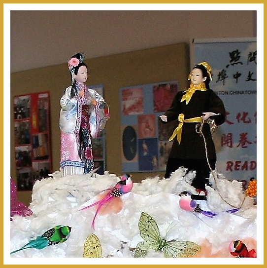 A display featuring characters inspired by The Legend Of Zhi Nu and Niu Lang. Chinese Valentine's Day celebrations are based on this story.