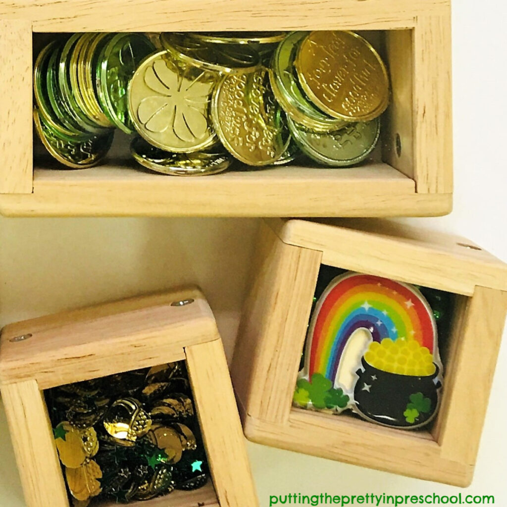 St. Patrick's Day treasure blocks featuring rainbow stickers, coins and pot of gold confetti.