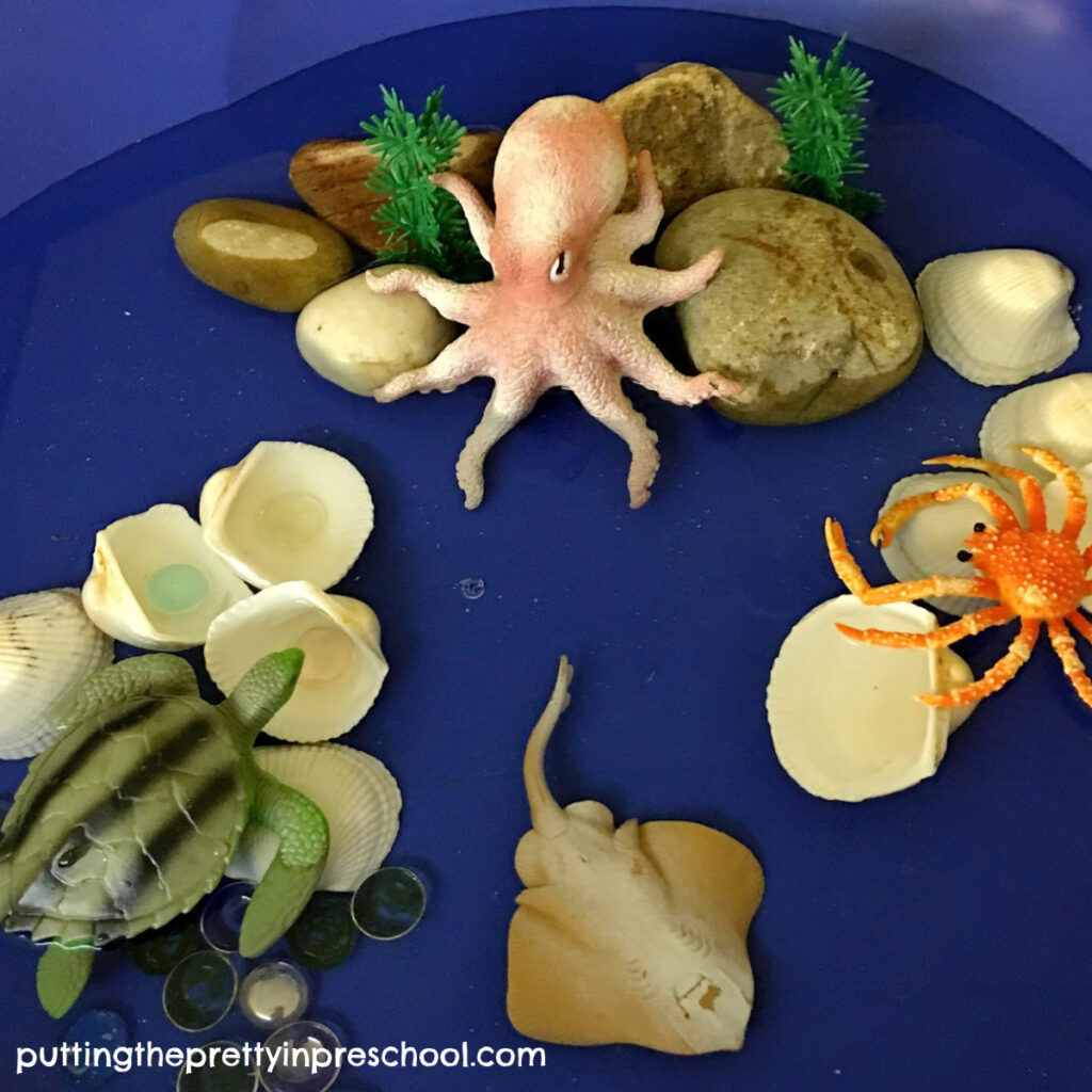 Invitation to add cheerios cereal to a painted octopus. All supplies for this craft are easily found in the kitchen. An all-ages art activity.