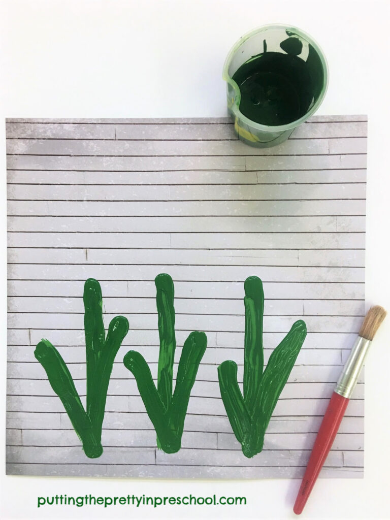 Green tulip stems painted on a rustic wood scrapbook paper background.