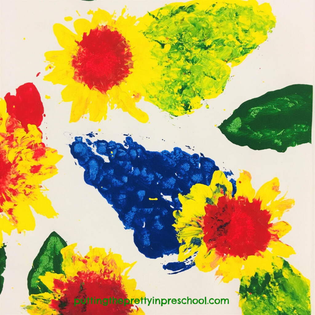 Paint prints with sunflowers. Tempera paint and primary colors used with leaves and heads of sunflowers. This is an all-ages activity.