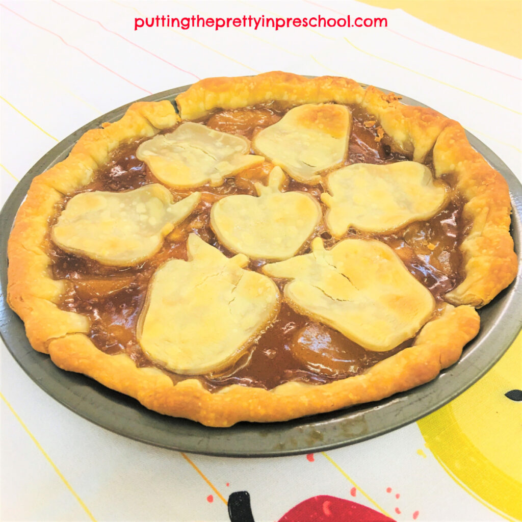 An early learner can easily help make this apple pie. It is made with a premade pie crust and apple pie filling.