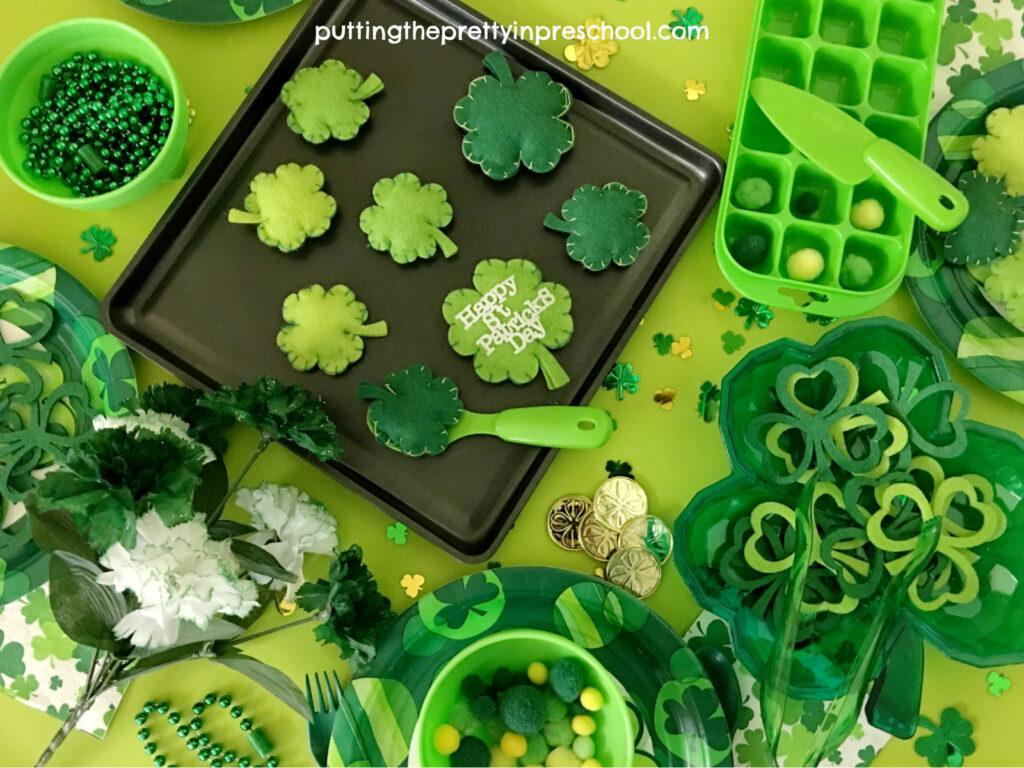 St. Patrick's Day house center dramatic play accessories. Tableware, play food, jewelry, coins, and decorations are included.