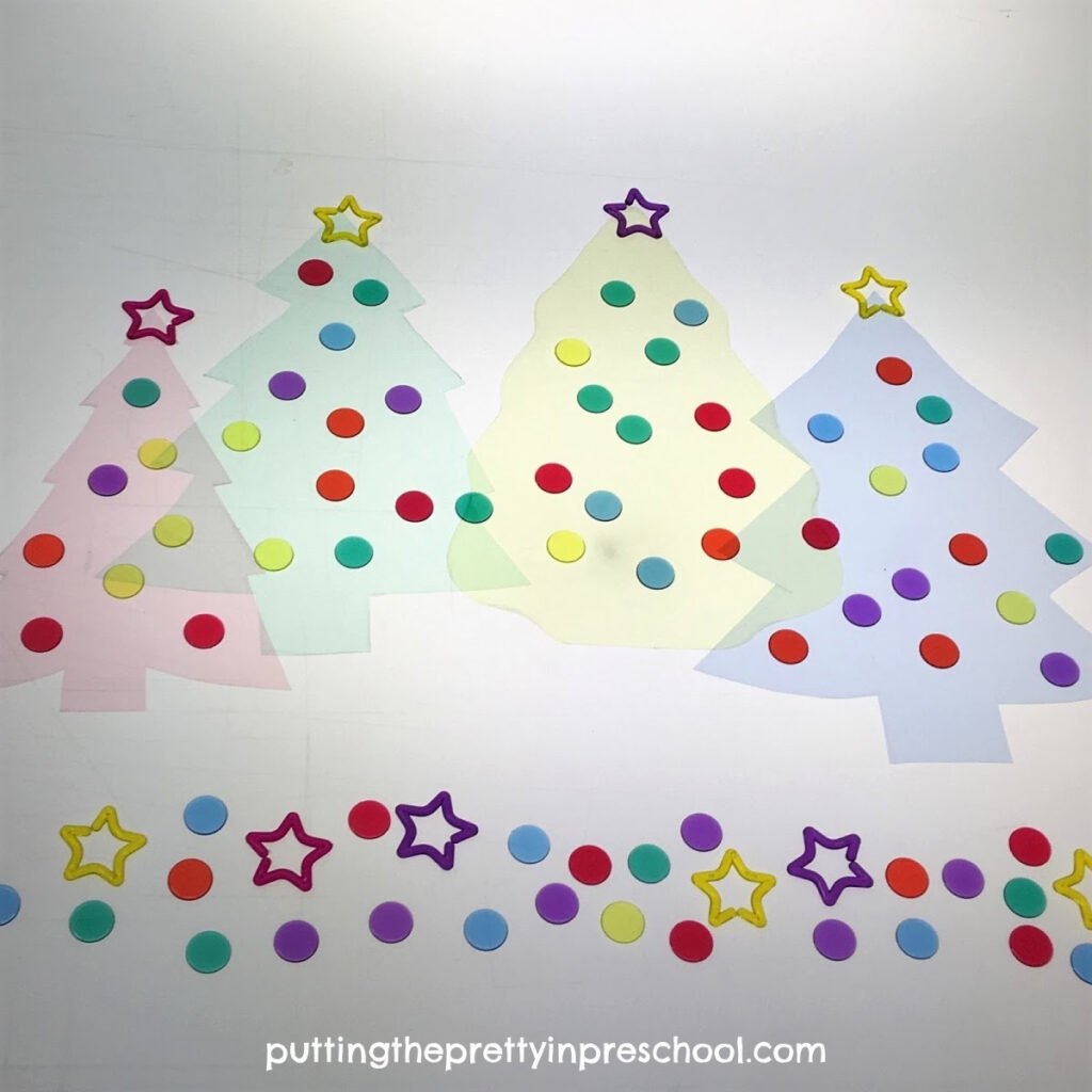 Transparent Christmas trees, star links, and game pieces.