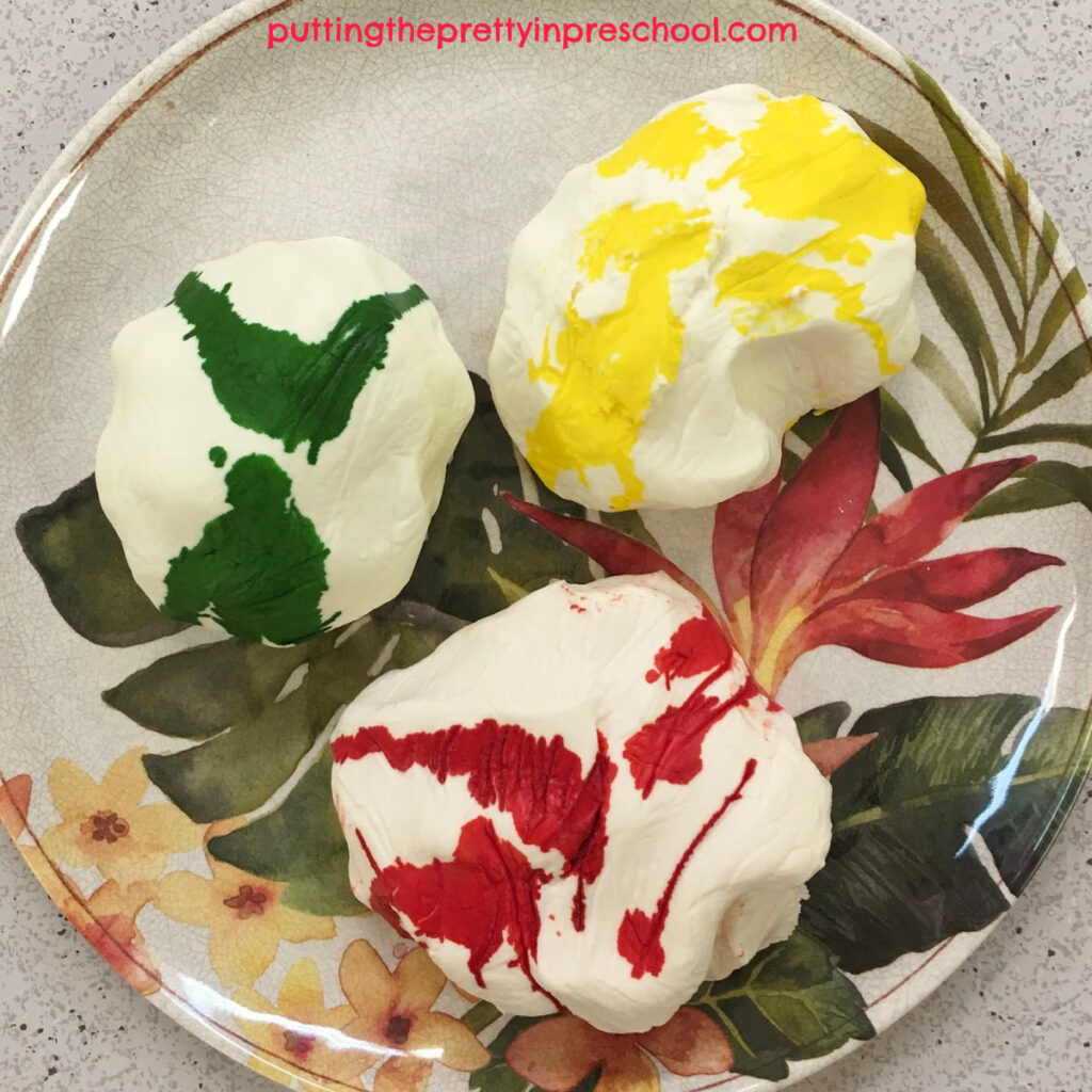 Two-ingredient scented playdough with food coloring ready to knead in.