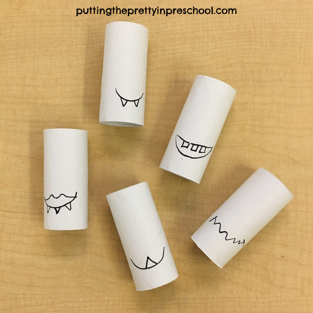 Mouths and teeth drawing on paper roll monsters.