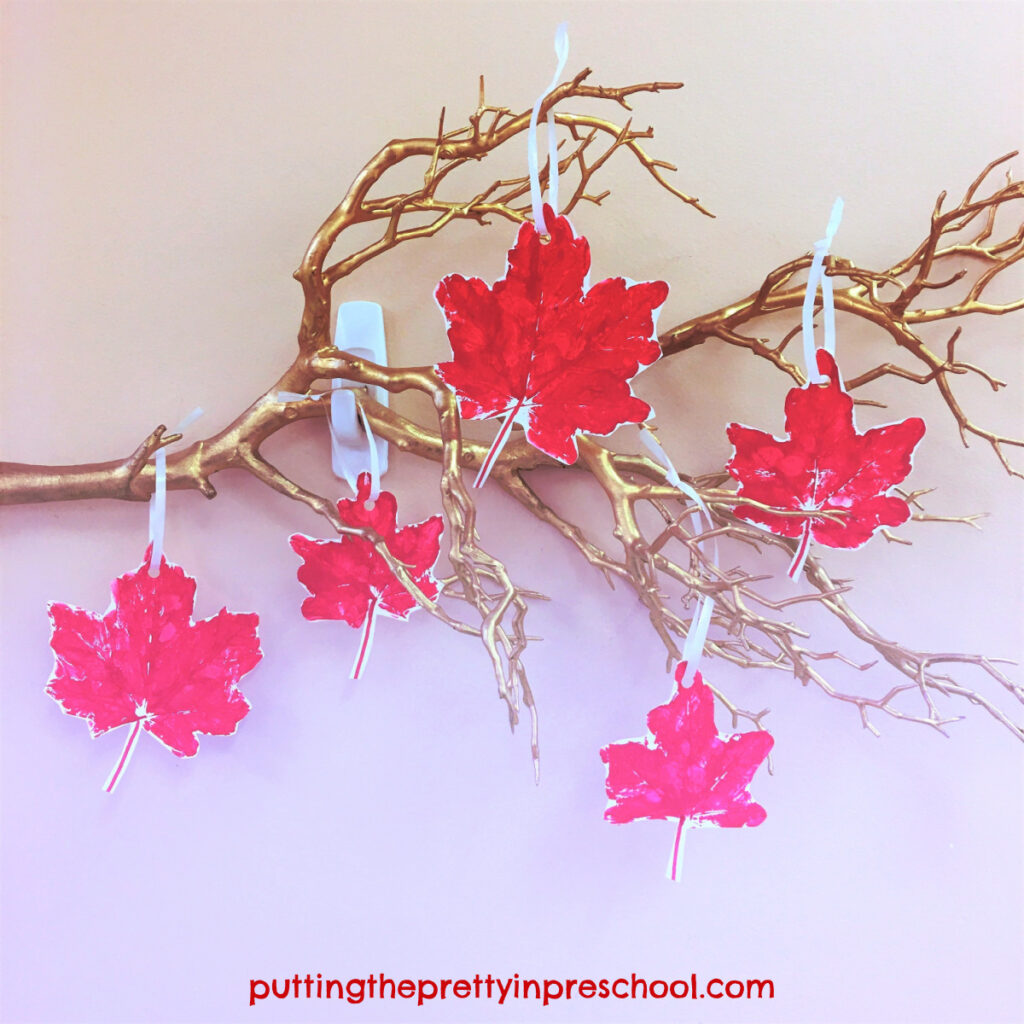 Leaf display on a twig made with maple leaf paint prints.