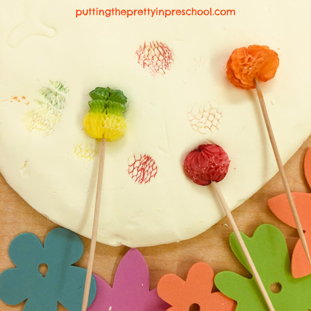 Tropical fruit toothpicks leave color on the scented, two-ingredient playdough.