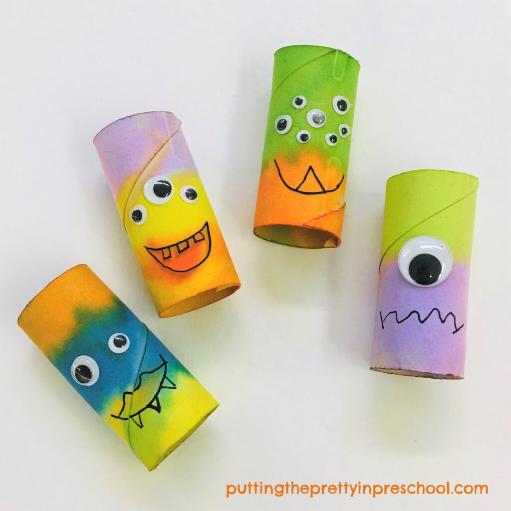 Toilet paper roll monsters ready to get their hair snipped and fashioned.