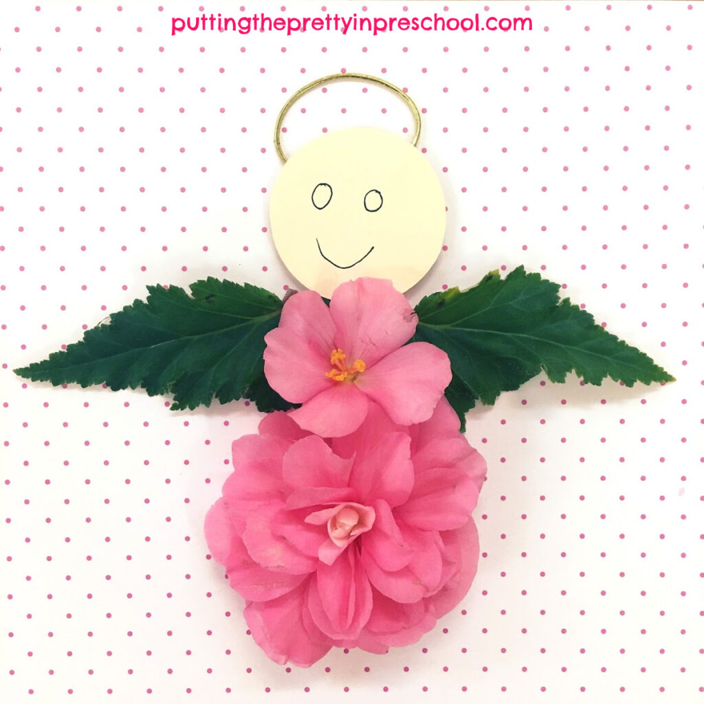 Flower angel made with nonstop pink begonia blooms.