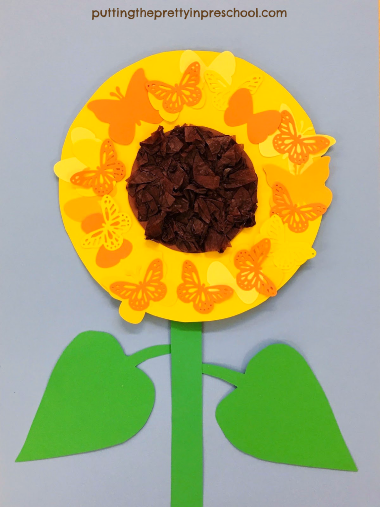 Easy to make butterfly sunflower papercraft. The sunflower head has a scrunched tissue center surrounded by paper butterflies.