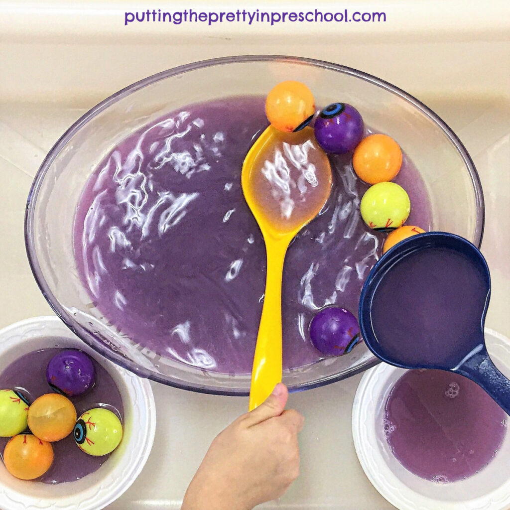 """Milky purple water and plastic eyeball """"soup"""" play station."""
