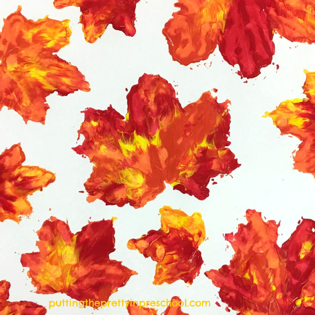 Tempera paint maple leaf prints.