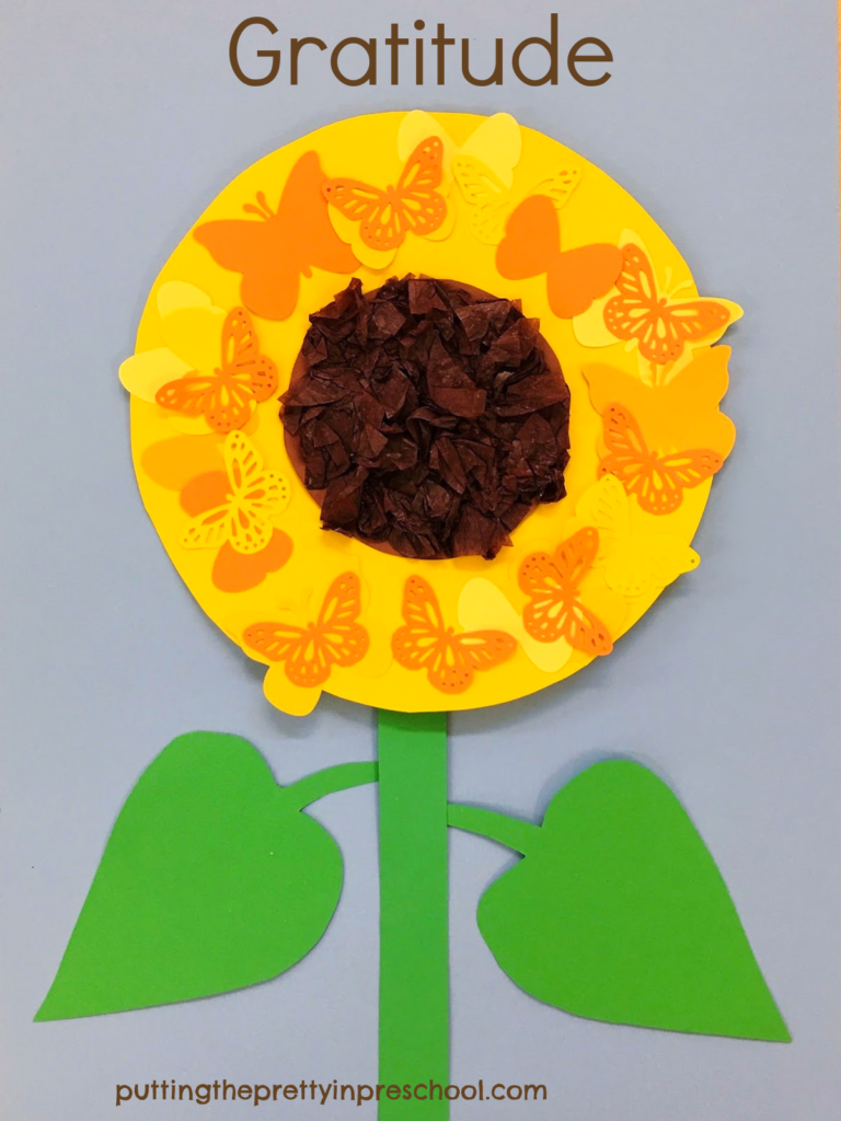 Thanksgiving Day inspired easy to make butterfly sunflower papercraft. The sunflower head has a scrunched tissue center surrounded by paper butterflies.