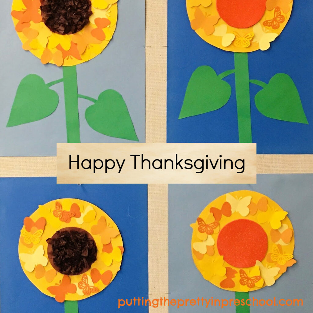 Happy Thanksgiving bulletin board display with butterfly-themed paper sunflowers.
