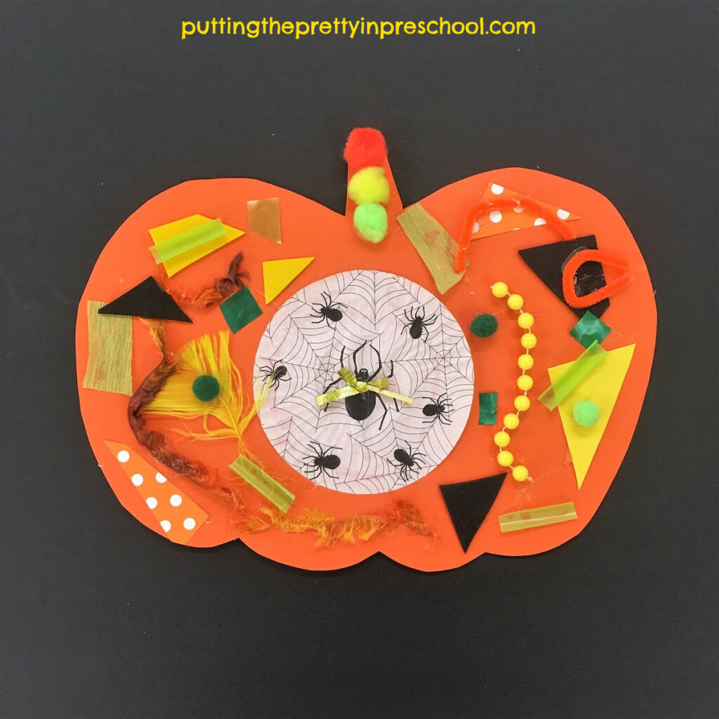 Pumpkin collage craft with textured green, yellow, orange, and black supplies.